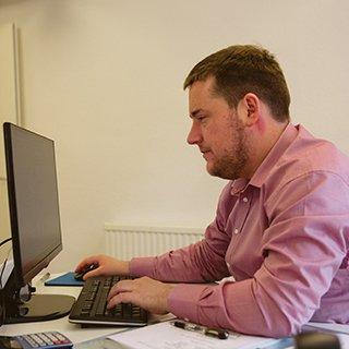 Adam Franks using computer